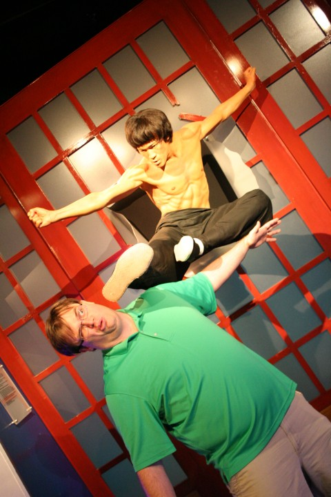 Craig is getting kicked in the face by Bruce Lee