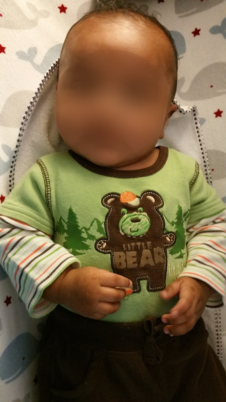 "A picture of a baby boy wearing a shirt that says ""Little Bear"" nicknames"